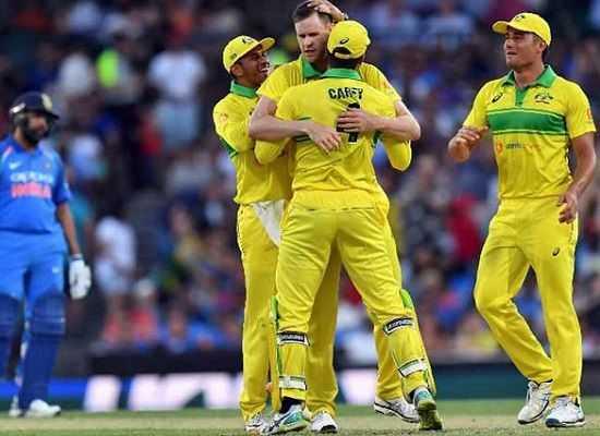 Australia triumph over India by 34 runs despite Rohit's 100
